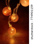 electric garland with red bulbs ...   Shutterstock . vector #774901159