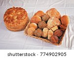 Small photo of various kinds of bread made from various flour in a wicker basket next Slava cake