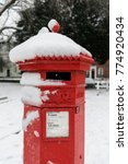 Red Post Box With Snow