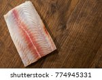 raw fish fillet on wooden table ... | Shutterstock . vector #774945331