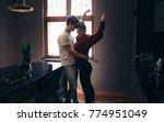 man hugging his girlfriend at... | Shutterstock . vector #774951049