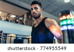 sportsman with lights around to ... | Shutterstock . vector #774955549