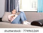 young woman lying on the sofa... | Shutterstock . vector #774961264