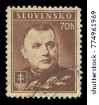 Small photo of Slovakia - stamp printed 1942, Standard edition photogravure printing, Dark brown color, Topic Heads of state, Series President, Definitive Issues, President Jozef Tiso
