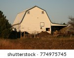 Small photo of Large white barn with a fresh coat of paint