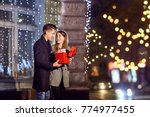 a man gives a box with a gift... | Shutterstock . vector #774977455