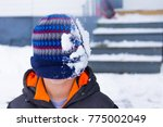 A Young Boy With Winter Hat...