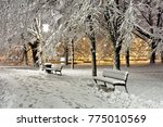 A Snow Covered City Park At...