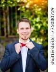 groom at wedding tuxedo smiling ... | Shutterstock . vector #775030729