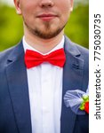 groom at wedding tuxedo smiling ... | Shutterstock . vector #775030735