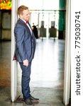 groom at wedding tuxedo smiling ... | Shutterstock . vector #775030741