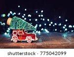 miniature red car with fir tree ... | Shutterstock . vector #775042099