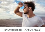 portrait of a relaxed young guy ... | Shutterstock . vector #775047619
