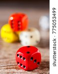Small photo of Playing dices in various colours / table game - strategy, coincidence and luck