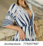 model in a print romper and... | Shutterstock . vector #775057987