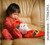 baby girl looking her christmas ...   Shutterstock . vector #775061911