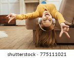 Stock photo being energetic pretty overjoyed young blond woman laughing and listening to music and wearing 775111021