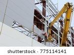 builder worker installing... | Shutterstock . vector #775114141