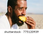 man with beard and dark skin... | Shutterstock . vector #775120939