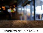 empty wooden table in front of... | Shutterstock . vector #775123015