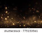 luxury gold bokeh on black... | Shutterstock . vector #775153561