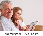 happy elderly couple reading a... | Shutterstock . vector #77518519