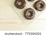 chocolate donuts on wooden... | Shutterstock . vector #775204201