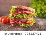 big sandwich on wood background | Shutterstock . vector #775227421