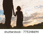 silhouette of father and... | Shutterstock . vector #775248694