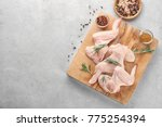 wooden board with raw chicken... | Shutterstock . vector #775254394