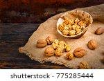 slightly scattered walnuts... | Shutterstock . vector #775285444
