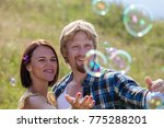 happy smiling couple in love... | Shutterstock . vector #775288201