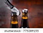 opening beer bottle with metal... | Shutterstock . vector #775289155
