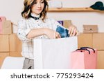 young clothing store manager... | Shutterstock . vector #775293424