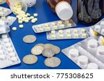 Small photo of Russian melallic coins ruble and tablet drugs as element of health. Expensive health care, rest of money after buying pills. affordable medicines.