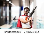 young super hero with a rifle | Shutterstock . vector #775323115
