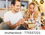 man surprise woman for chrismas | Shutterstock . vector #775337221