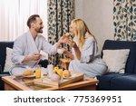 happy mature man in bathrobe... | Shutterstock . vector #775369951