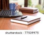 organizers   pen  laptop a cup...   Shutterstock . vector #77539975