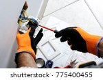 electrician working safely on... | Shutterstock . vector #775400455