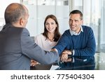 businessman shaking hand with a ... | Shutterstock . vector #775404304