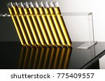 a row of test tubes with golden ... | Shutterstock . vector #775409557