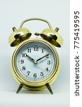 Small photo of Golden alarm bell clock isolated on white background
