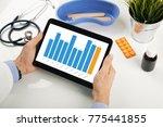 doctor analyzing healthcare... | Shutterstock . vector #775441855