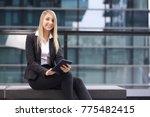 young businesswoman working... | Shutterstock . vector #775482415