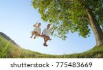 low angle view smiling boy and... | Shutterstock . vector #775483669