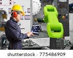 engineer using laptop computer... | Shutterstock . vector #775486909