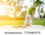 coins in glass bottles  savings ...   Shutterstock . vector #775489375