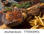 cooked grass fed tomahawk... | Shutterstock . vector #775543951