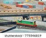 locomotive under bridge in port